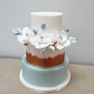 Bronze and blue  modern wedding cake with sugar flowers