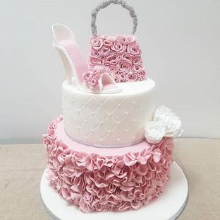 Pink ruffle shoe and handbag cake