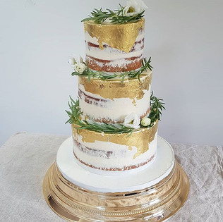 Three tier semi naked cake with gold lea