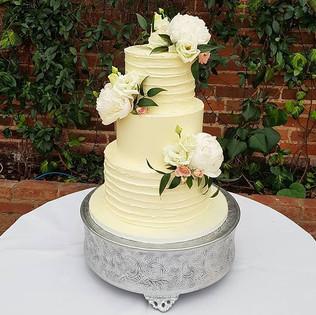 Three tier buttercream wedding cake with
