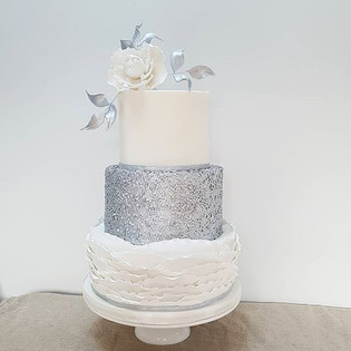 White and silver 3 tier cake with ruffle