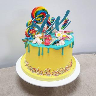 Rainbow drip cake with retro sweets