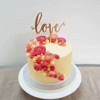 Buttercream flower engagement cake