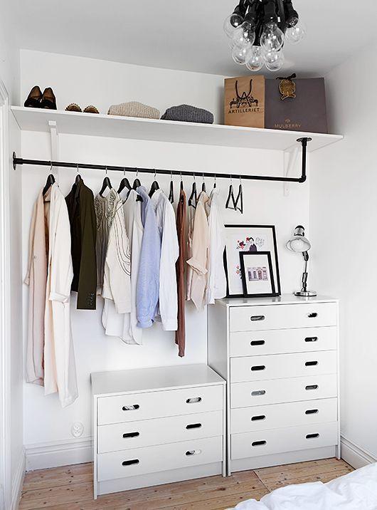 Arrumar roupa com arara e armario