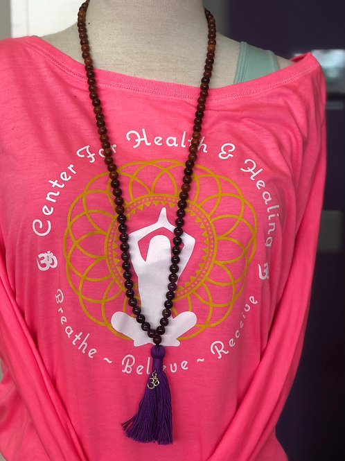 wood and purple stones mala with purple tassel with om