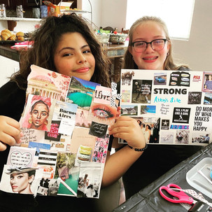 young girls working on vision boards
