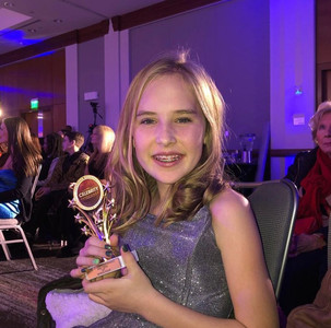 girl accepting all star award