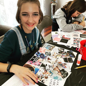 girl working on a motivating vision board