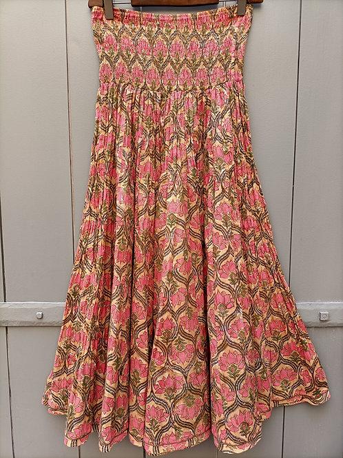 Jupe en coton imprimé à motifs floral rose corail et vert sur fond crème