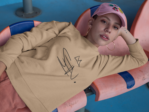 girl-lying-down-on-chairs-at-a-stadium-wearing-a-crewneck-sweater-mockup-a18411.png