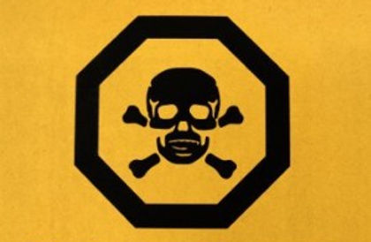 An icon of a skull and crossbones inside a octagon indicating poison is displayed on a yellow background.