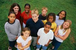Kids standing in a field.