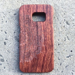 Mandala etched wooden phone case
