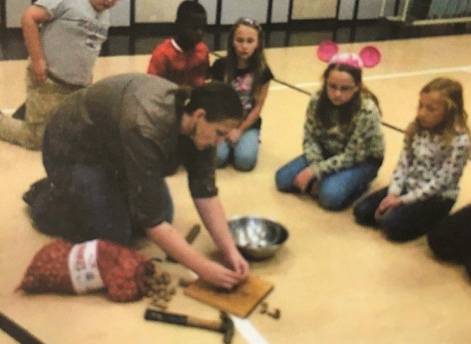 Community Public Relations & bridge builder with local tribes, other government agencies, and NGOs including creation of cultural, art, and environmental educationoutreach: (former Wiyot cultural director/ current Tolowa Dee-ni' Nation's Chief Governance Officer Briannon Fraley demonstrates acorn processing to second graders), Dow's Prairie Elementary School, CA.