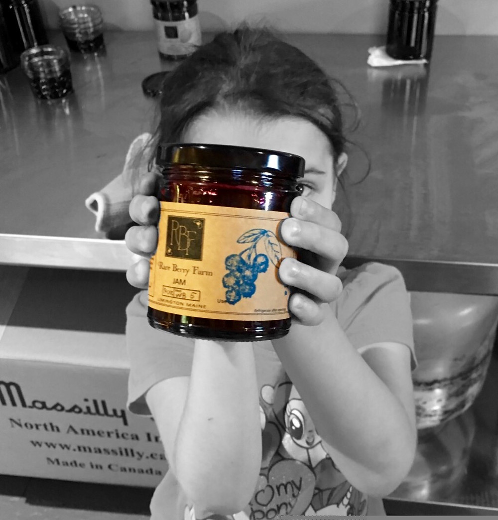 Lacey holding jam jar