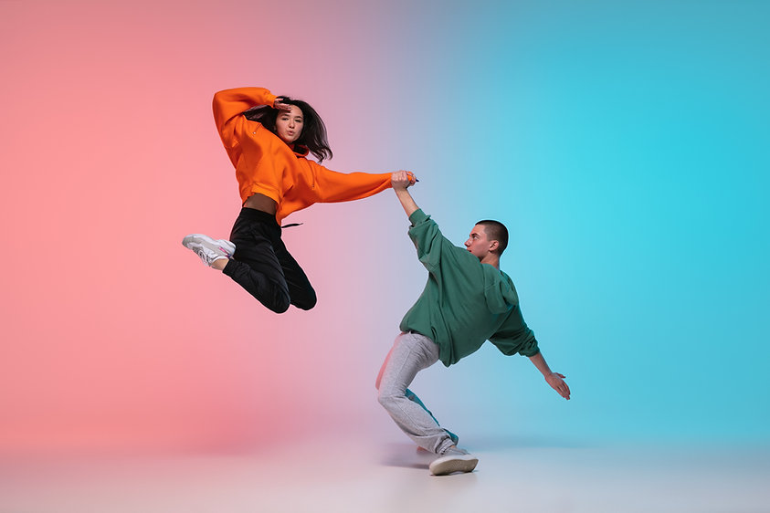 In jump. Boy and girl dancing hip-hop in
