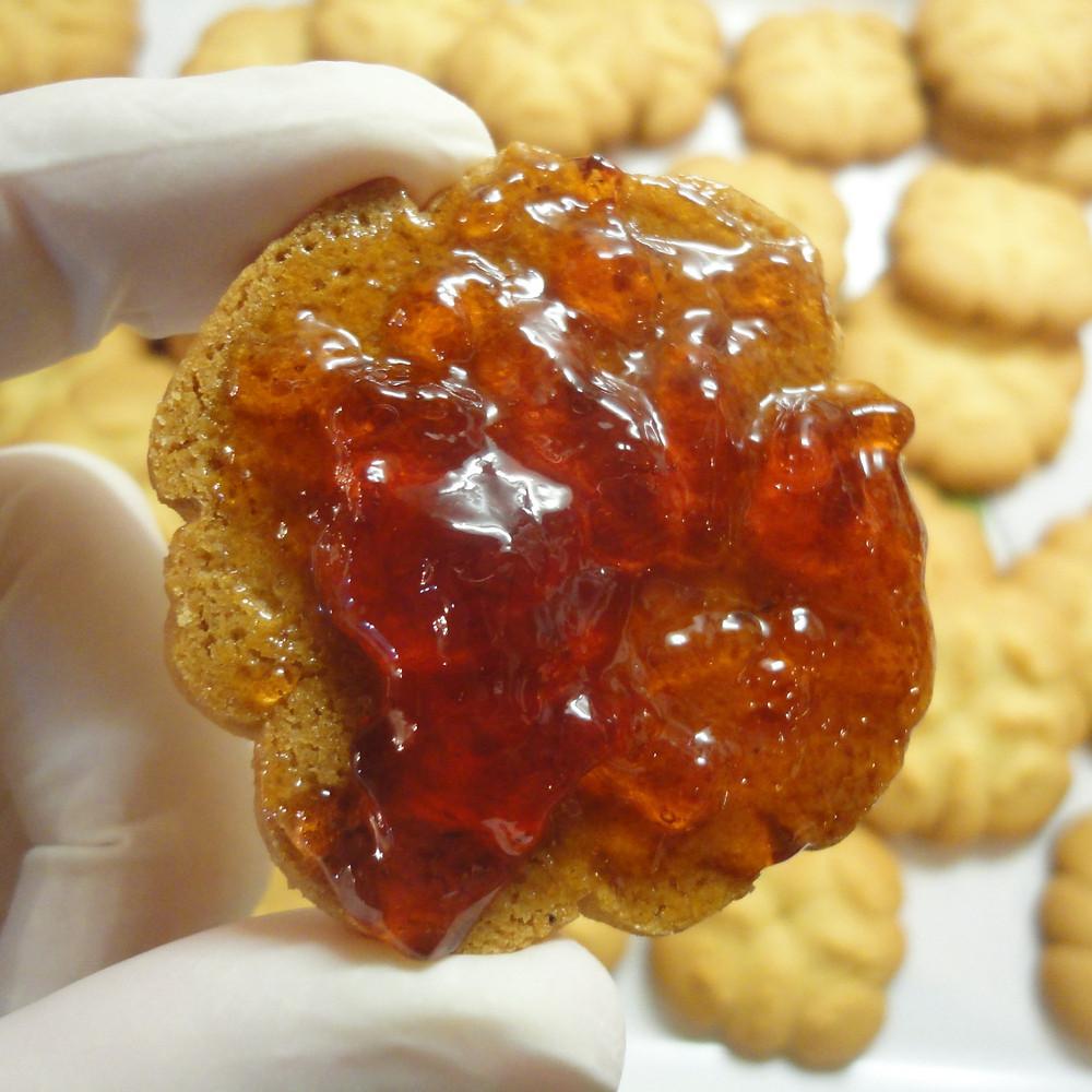 Jam spread onto biscuit