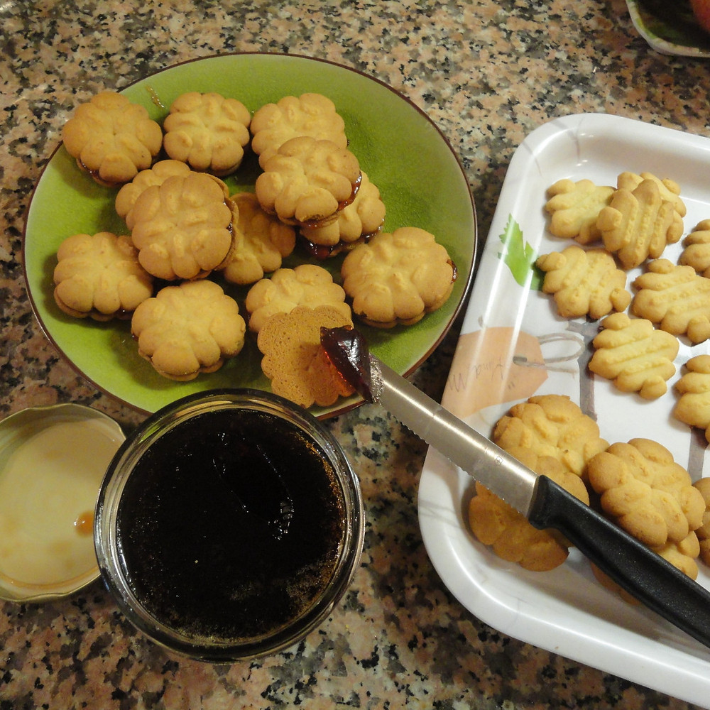 Spread jam onto biscuits