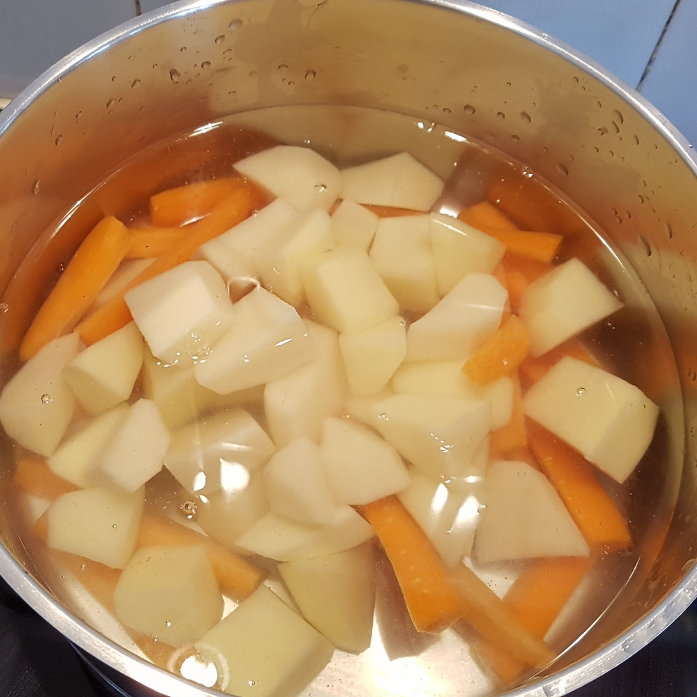 potatoes and carrots in cassarole with plenty of water