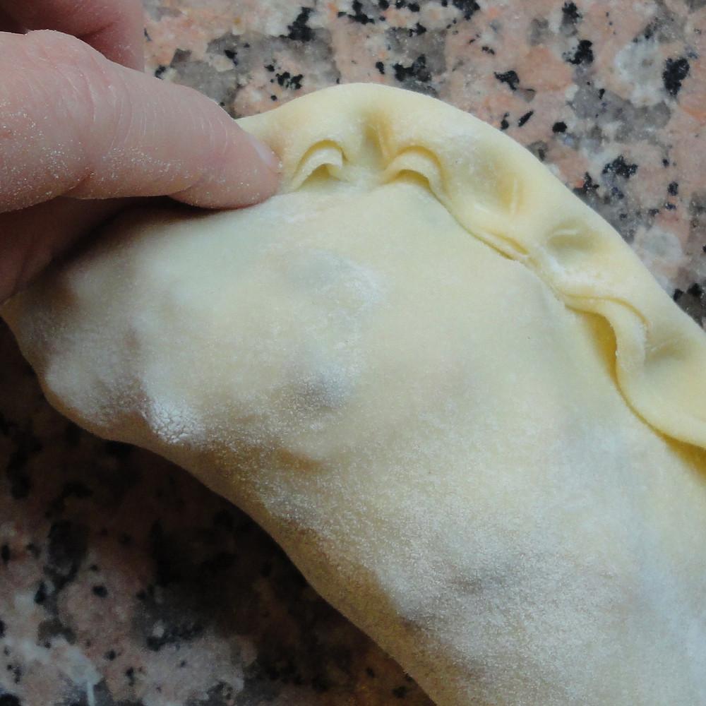 close each pie by hand
