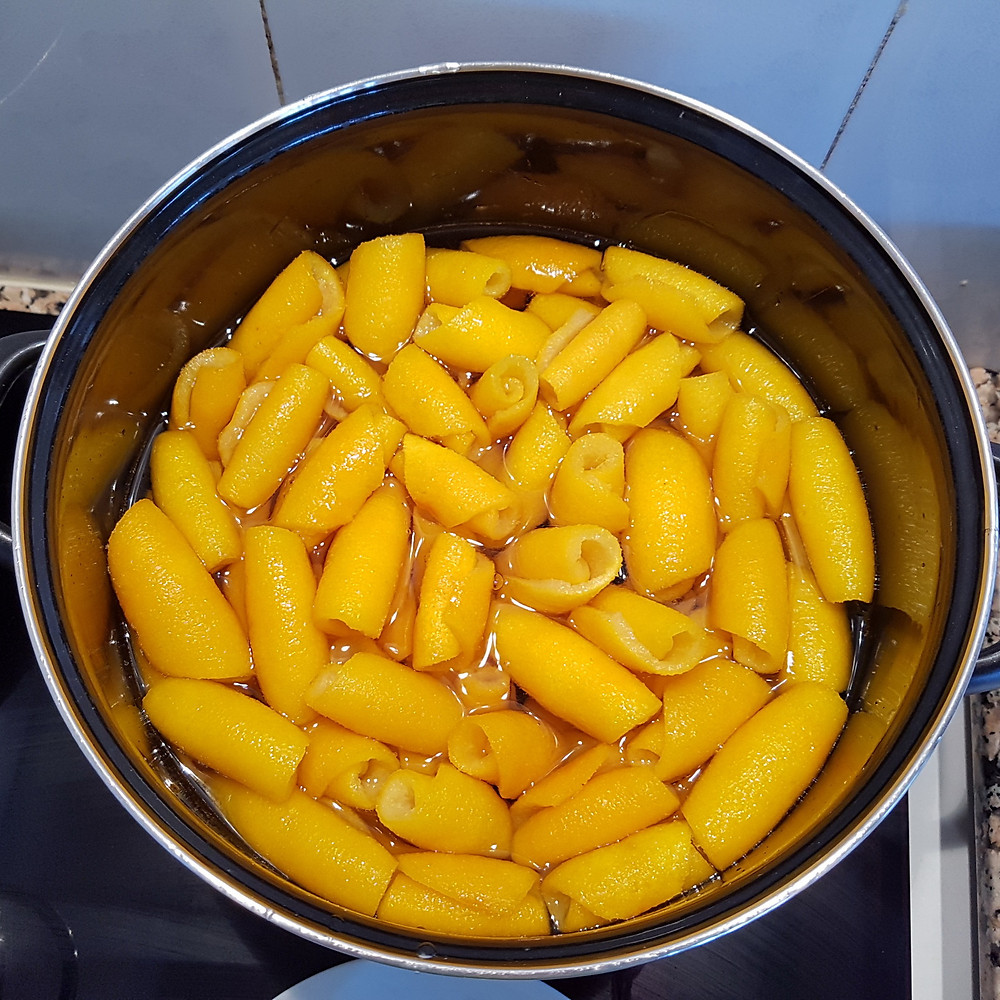boil orange peels in the sugar