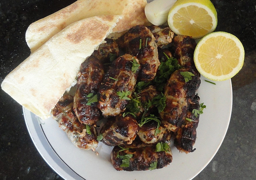 Sheftalia with pita bread, onion, fresh lemon and parsley