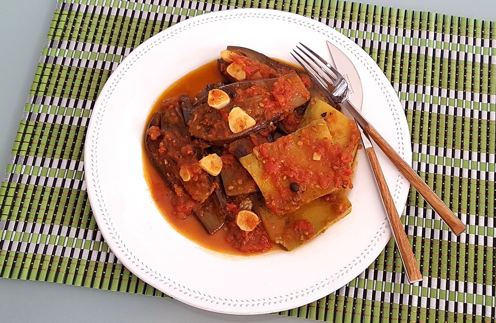 Eggplant and zucchini slices cooked in tomato sauce with garlic