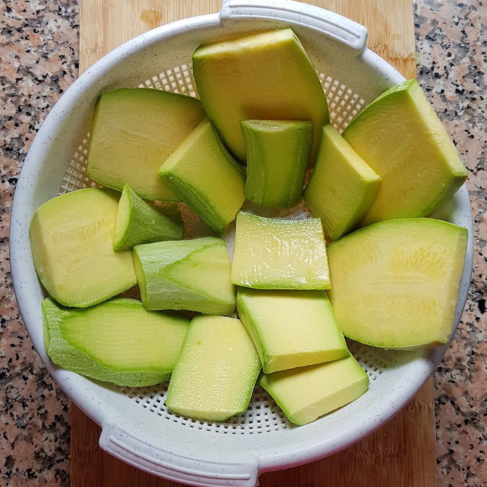 slices of zucchini in a colander