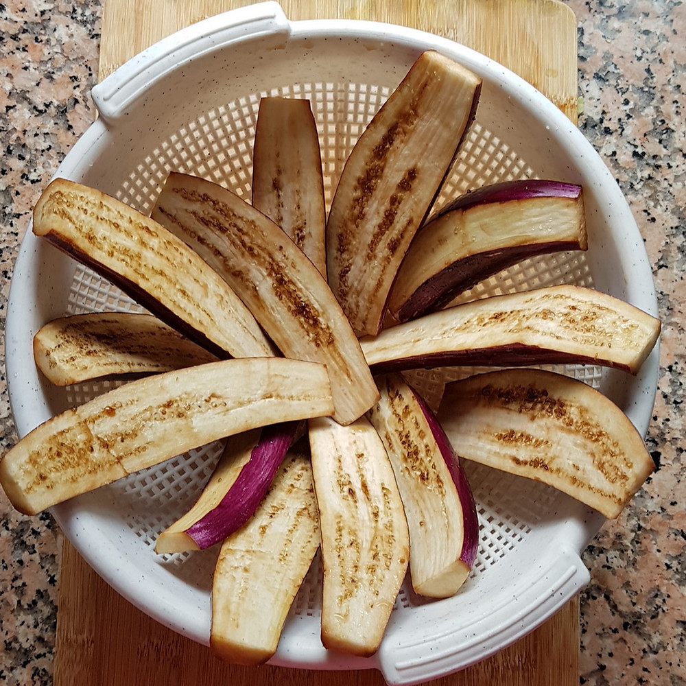 slices of eggplant in a colander