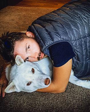 owner cuddles Jindo dog