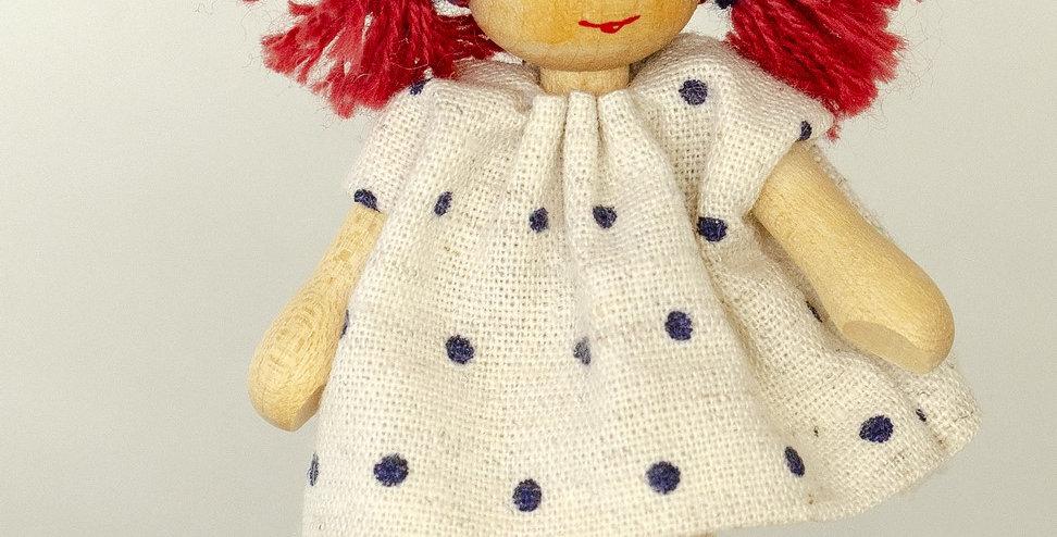 Puppenmädchen im Handdruckkleid
