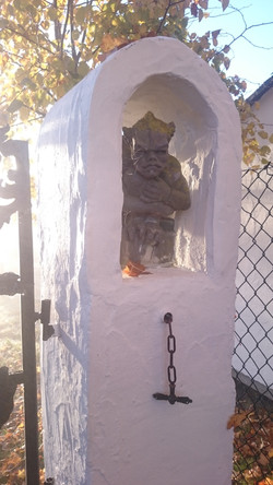 Gate post with grotesque