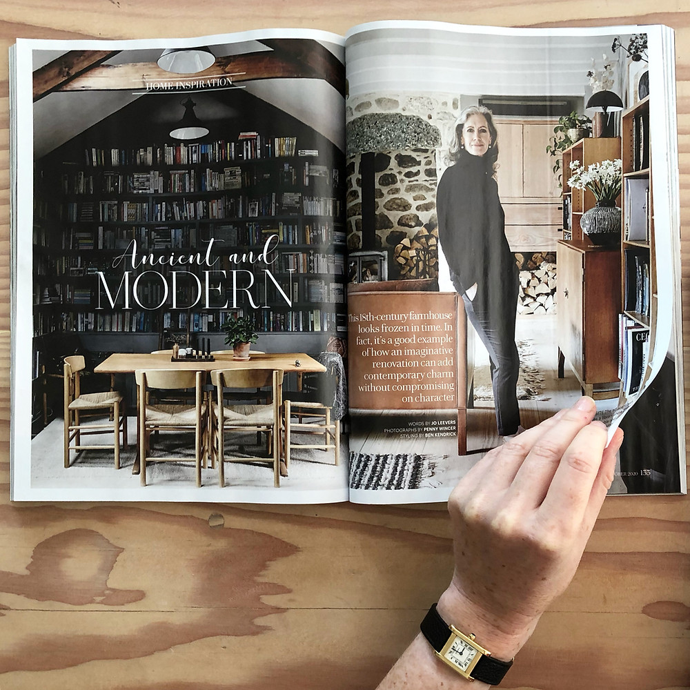 Hand turning pages in magazine