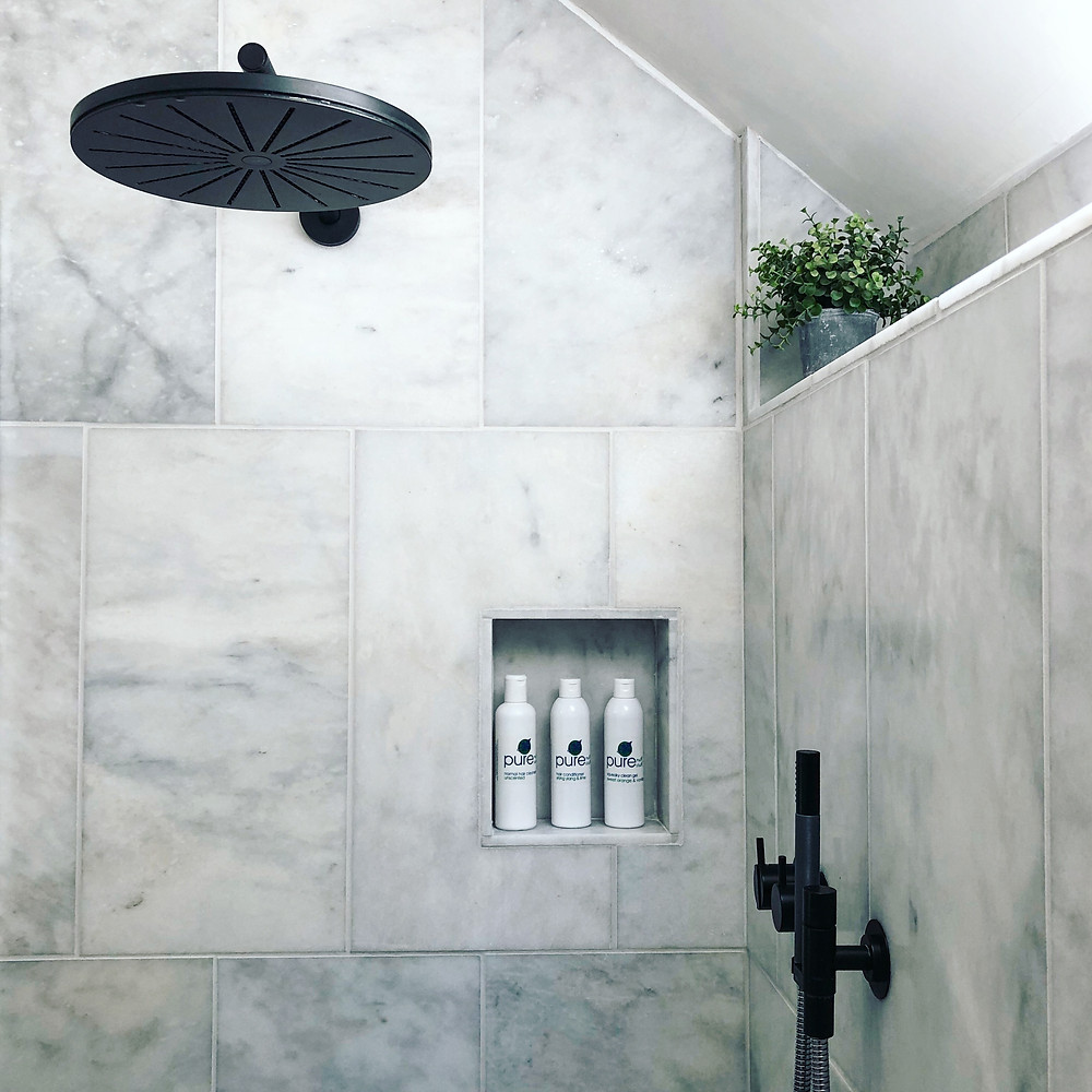Marble shower room in holiday cottage