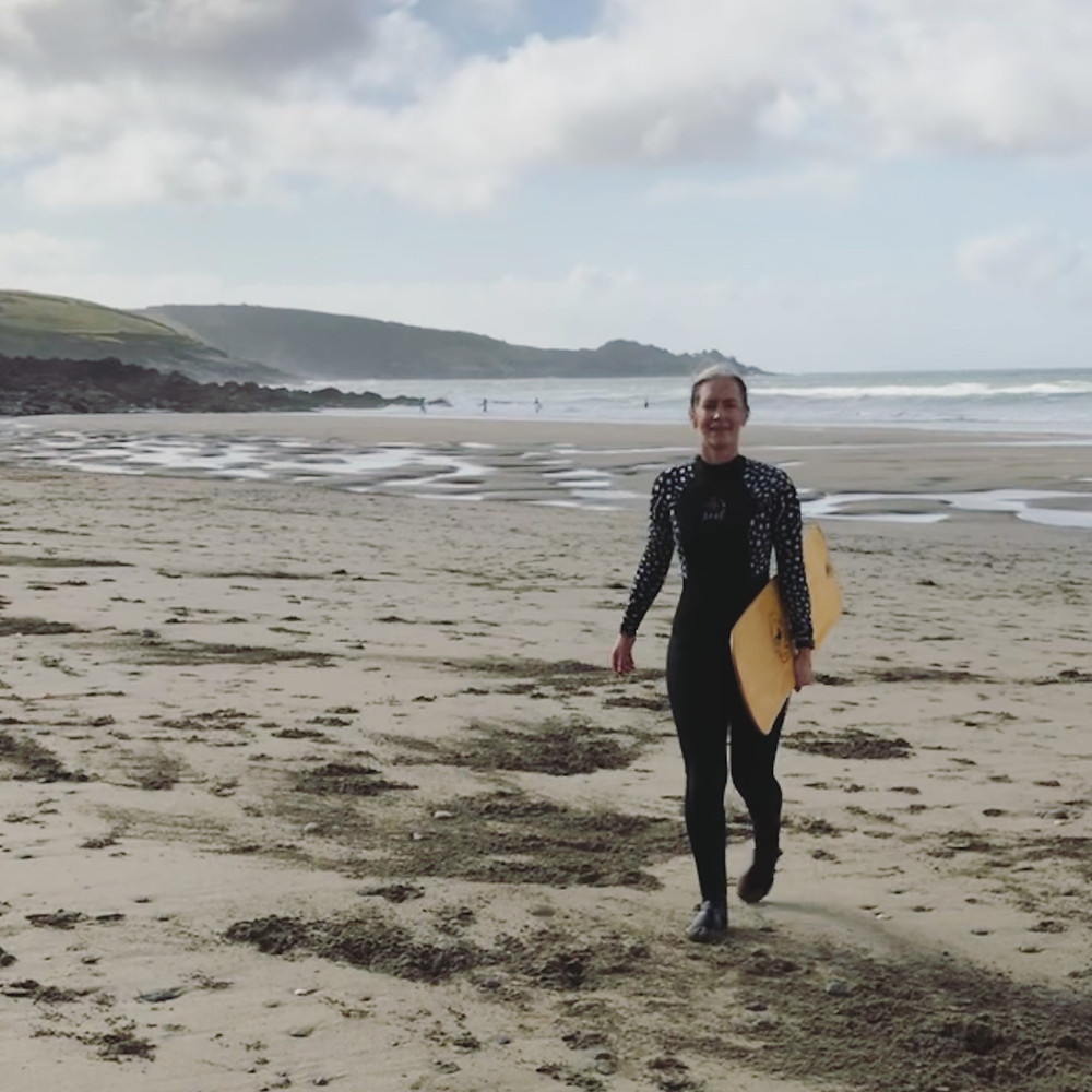 A bellyboarder on the beach
