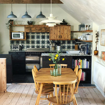 Vintage Ercol dining suite and reclaimed wood in The Old Granary