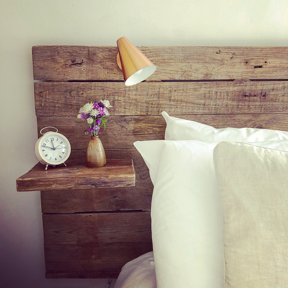 Bed headboard made from reclaimed wood