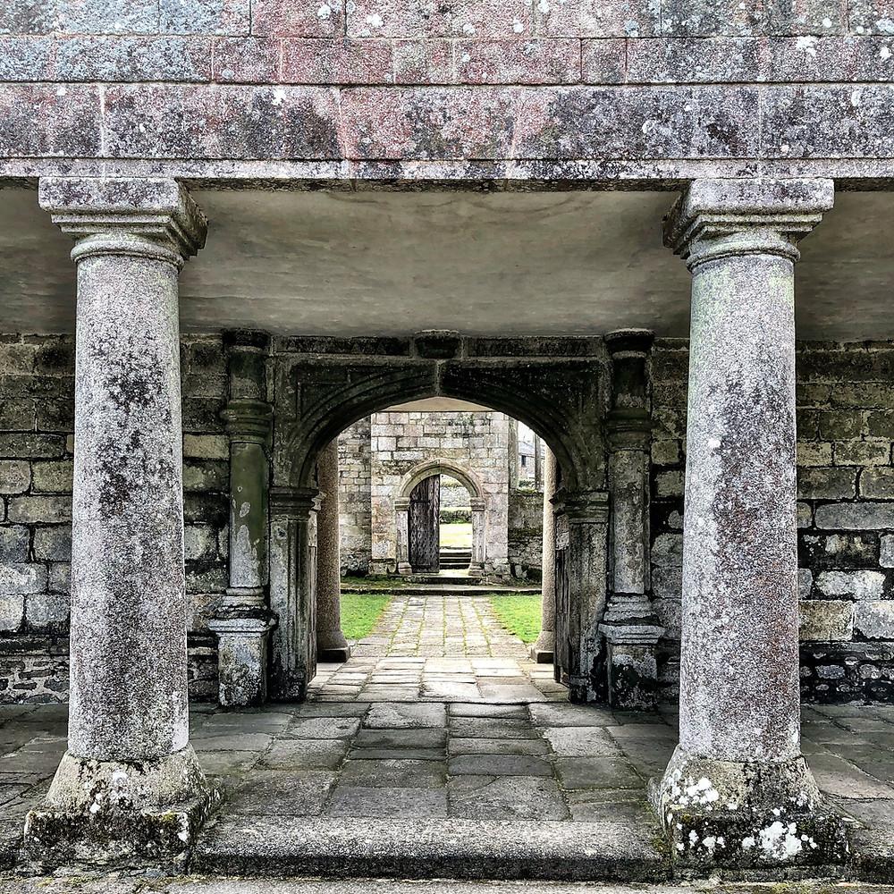 Stone pillars flank the entrance to historic Godolphin House