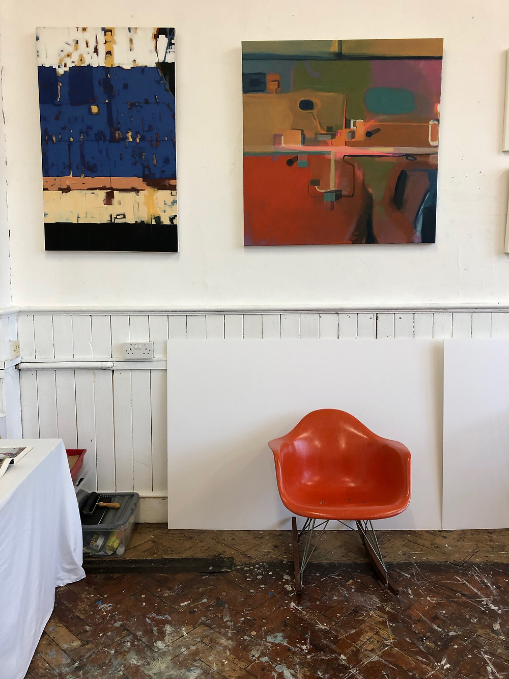 Artist's studio at Krowji in Cornwall with red Eames chair