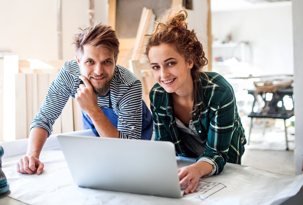 young-couple-with-laptop-in-the-carpente