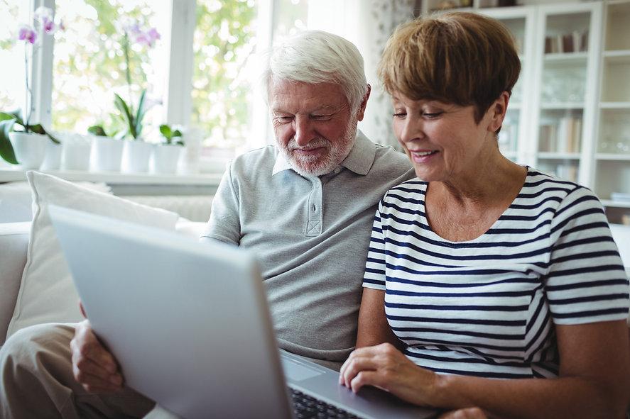 senior-couple-using-laptop-VS79ZDG_edite