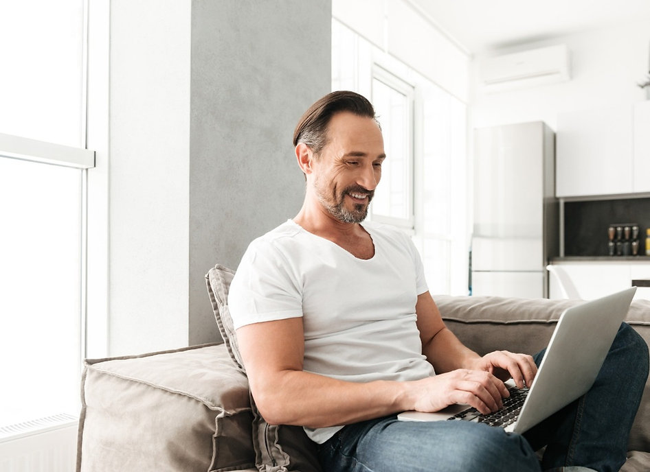happy-mature-man-using-laptop-computer-P