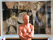 Image of a clay sculpture of a man's torso and head used as a placeholder