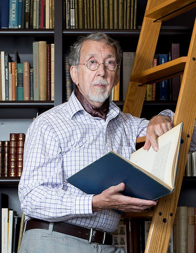 Dr. Peter Bullough in his beloved library