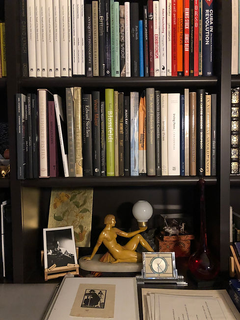 Dr. Bullough's library showing books and objet d'arts