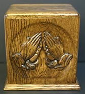 Hand carved praying hands companion funeral urns, shown in oak wood