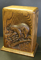 Bear funeral urn, carved bear funeral urn,wooden urns,funeral urns,creamation urns,carved urns,houle s custom woodcarving,