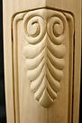 hand carved cherry corner post featuring owl eyes design