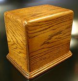 Dinney funeral urn,wooden urns,carved funeral urns,cremattion urn,oak urns,houles custom woodcarving