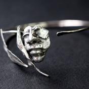 Bracelet with a mask